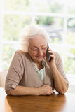 Elderly woman phone calling Royalty Free Stock Photography