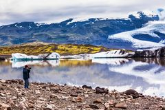 The elderly woman photographs the lagoon Stock Photography