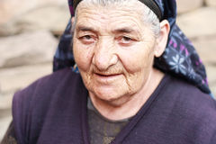 Elderly woman with piercing gaze. Closeup outdoor photo Stock Images