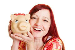 Elderly woman with piggy bank Royalty Free Stock Photography