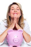 Elderly woman with piggy bank. Royalty Free Stock Photo