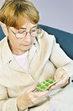 Elderly woman with pill box. Elderly woman holding pill box with medication Royalty Free Stock Photography