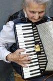 Elderly woman playing accordion. Royalty Free Stock Photo