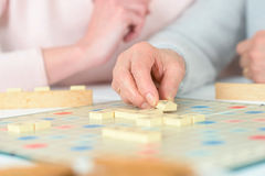 Elderly woman playing board game Royalty Free Stock Image