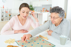 Elderly woman playing board game Stock Photo