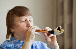 Elderly woman playing music Royalty Free Stock Photos