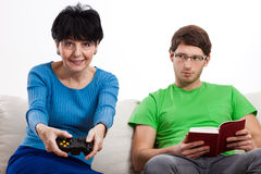 Elderly woman playing vdeo game Stock Photo