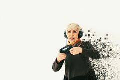 An elderly woman plays a video game and is fragmented into pixels. A conceptual photo with visual effects meaning an. Elderly person and new technologies Stock Photos