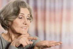 Elderly woman pointing Stock Image
