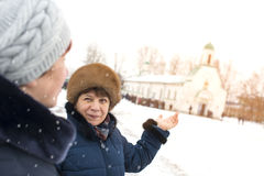 An elderly woman is pointing at the temple. Royalty Free Stock Images