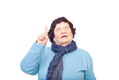 Elderly woman pointing up Stock Photo
