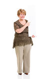 Elderly woman pointing white board Royalty Free Stock Photos