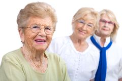 Elderly woman portrait with girlfriends. Stock Photos
