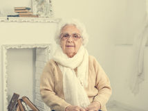 Elderly woman portrait. In interior stock photo