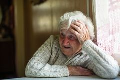 Elderly woman portrait looking at the camera. royalty free stock image