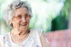 Elderly woman. Portrait of a smiling elderly woman royalty free stock image
