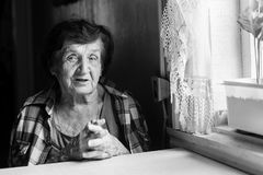 An elderly woman portrait in a village house. Stock Photography