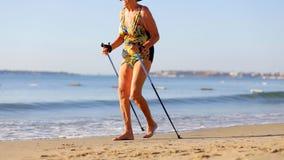An elderly woman practicing Nordic walking
