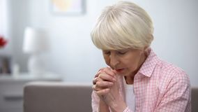 Free Elderly Woman Praying To God, Asking For Mercy And Help, Christian Tradition Stock Images - 157313094