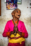 Elderly woman prays in a local retirement home, Nepal Royalty Free Stock Photography