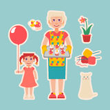 Elderly woman prepared cakes for her granddaughter Royalty Free Stock Images