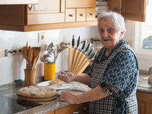 Elderly woman preparing croquettes Stock Images