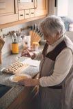 Elderly woman preparing croquettes Royalty Free Stock Photo