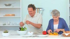 Elderly woman preparing the dinner stock video footage