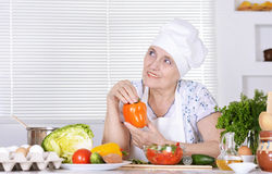 Elderly woman preparing Royalty Free Stock Photos