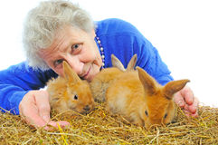 Elderly woman with rabbit Royalty Free Stock Image