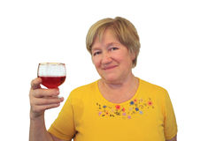 Elderly woman raised a glass of wine Royalty Free Stock Images