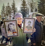 An elderly woman in the ranks of the Immortal regiment. Royalty Free Stock Image