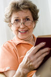 Elderly woman reading royalty free stock image