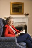 Elderly woman reading. stock images