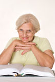 Elderly woman reading a book Stock Photo