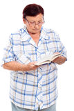 Elderly woman reading book Stock Photo