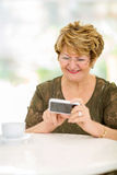 Elderly woman reading emails Royalty Free Stock Photo
