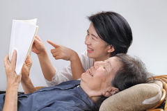 Elderly woman reading fable book with daughter Royalty Free Stock Photo