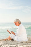 Elderly woman reading her book Royalty Free Stock Images