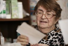 Elderly woman reading a letter Royalty Free Stock Photos