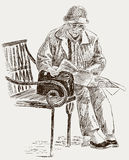 Elderly woman reading a newspaper Royalty Free Stock Images