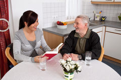 Elderly woman reads Stock Photo