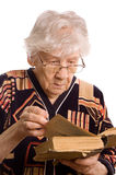 Elderly woman reads the book Royalty Free Stock Photo