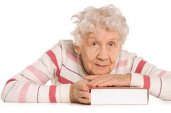 The elderly woman reads the book Royalty Free Stock Image
