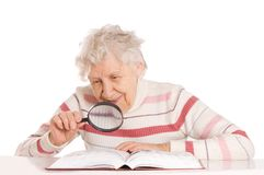 Elderly woman reads the book Royalty Free Stock Image
