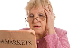 Elderly woman reads the newspaper Stock Photography