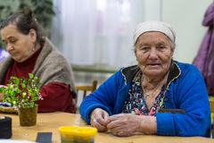 Elderly woman in rehabilitation department in Center of social services for pensioners and the disabled Royalty Free Stock Photo