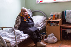 Elderly woman in rehabilitation department in Center of social services for pensioners and the disabled. Royalty Free Stock Photos