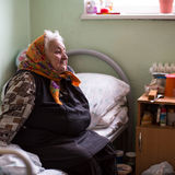 Elderly woman in rehabilitation department in Center of social services for pensioners and the disabled. Stock Images