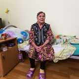 Elderly woman in rehabilitation department in Center of social services for pensioners and the disabled. Stock Photos